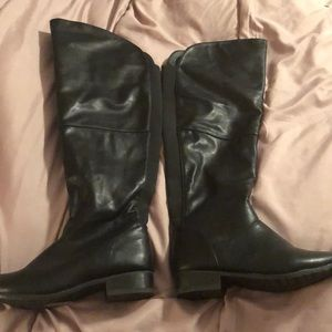 Above knee black leather boots